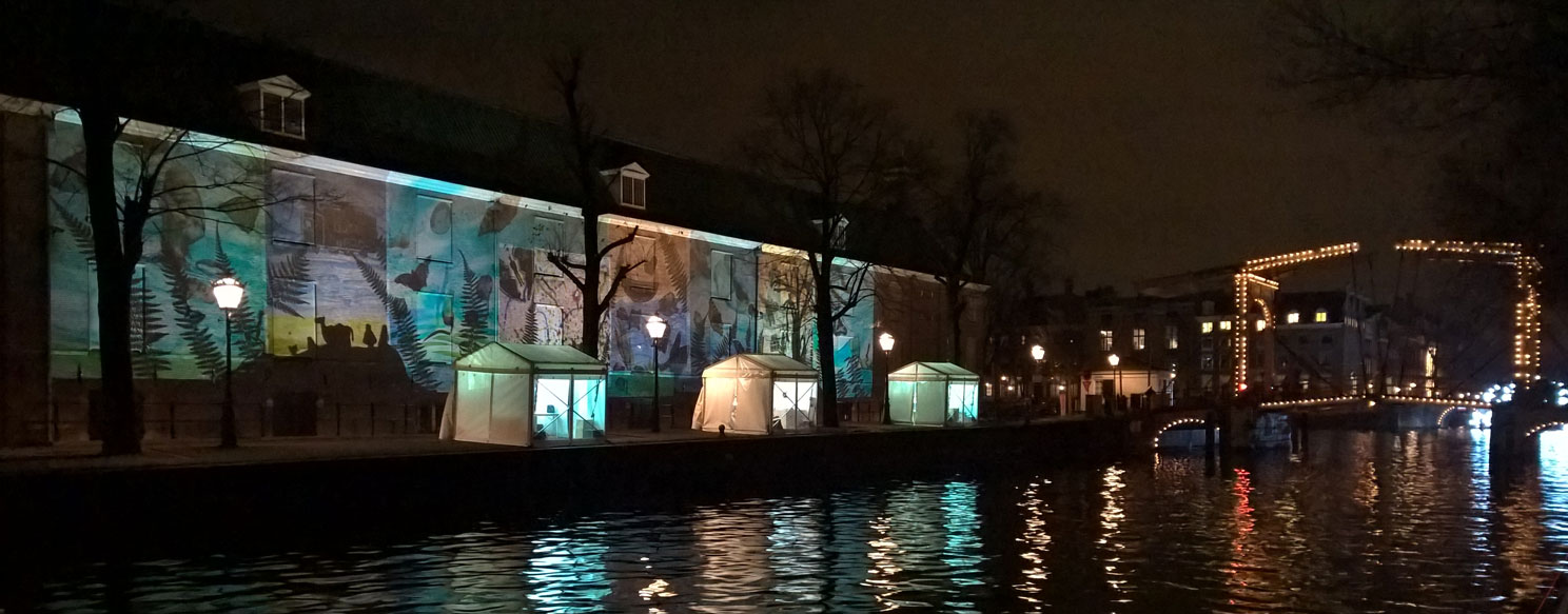 Coloured projections at  Amsterdam Light Festival 2017-2018 near Amsterdam Hermitage Museum